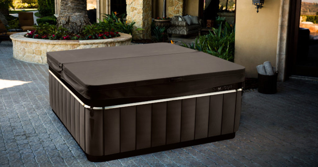 Hot tub with a cover on a paved patio