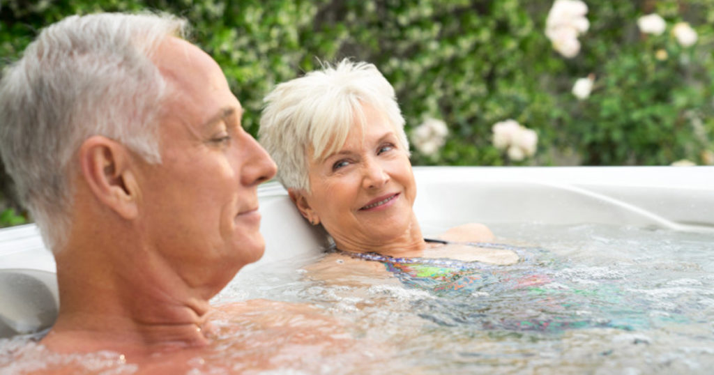 A couple soaking in a hot tub